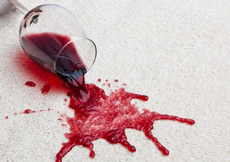 stained carpet with a spilt glass of red wine